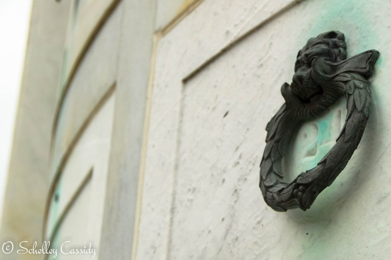 A lion handle adorns a tomb in New Orleans, Louisiana.