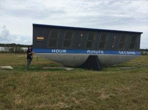 I am so small compared to the countdown clock. This is being retired and replaced with a new clock with LED lights.